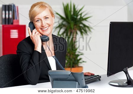 Secretary Talking On Phone With Client
