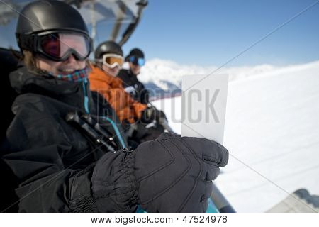 Winter Sport Friends In Chair Lift With Ticket