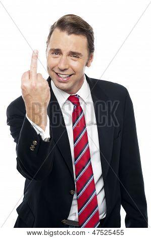 Displeased Businessman Showing Middle Finger Politely