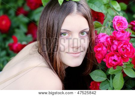 Happy Young Woman In The Garden