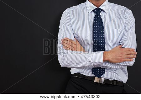 Close up of businessman with arms crossed