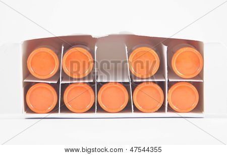 Top View Of Orange Cap Injection In Box