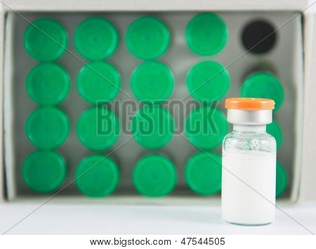Injection Vial On Green Vials Background
