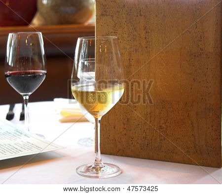 white and red wine with generic menu in restaurant