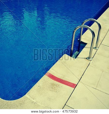 detail of an outdoors swimming pool in the summer