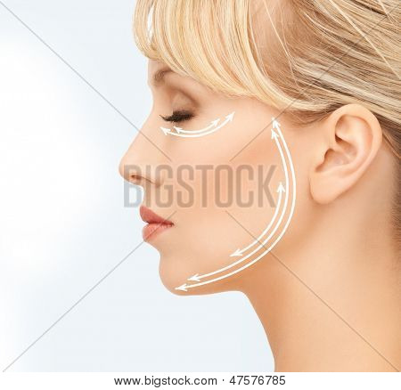 close up of beautiful young woman face with arrows