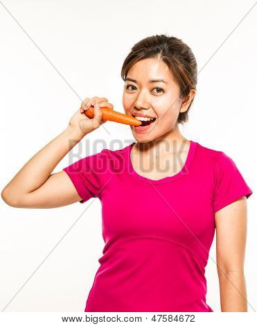 asian woman eats a carrot