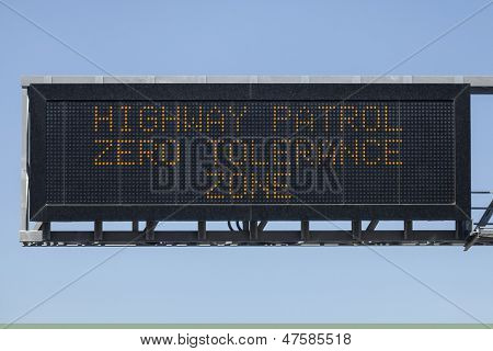 Highway Patrol zero tolerance zone electric warning sign.