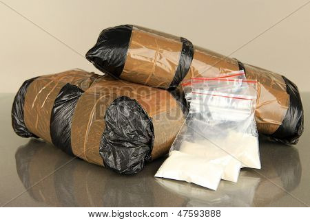 Packages of  narcotics on gray background