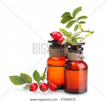 medicine bottles with hip roses, isolated on white poster