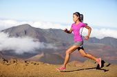 Female running athlete. Woman trail runner sprinting for success goals and healthy lifestyle in amazing nature landscape. Cross country run with fit female fitness model running at fast speed. poster