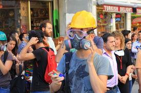 A demonstrator wearing gas-mask