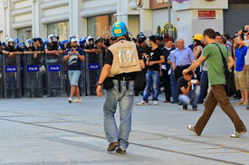 Agency photographer between demonstrators and police line