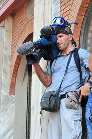 Cameraman recording the demonstratio