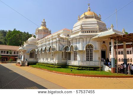 Shri Mangeshifamous hindu Temple in Mardol Goa India with a mix of Indian and Portuguese architecture poster