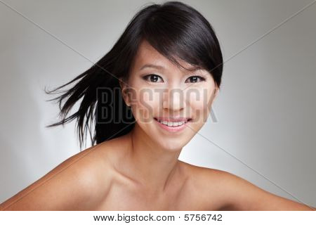 Beauty shot of an attractive Japanese beautiful gal with an eager and enthusiastic expression poster