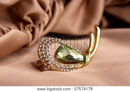Beautiful jewelry jewelry on the background of silk