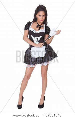 Beautiful sensual woman posing in a skimpy maids uniform with miniskirt on a white background poster