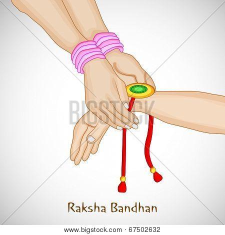 Beautiful background for Raksha Bandhan celebrations with girl tying rakhi on brother hand on grey background.