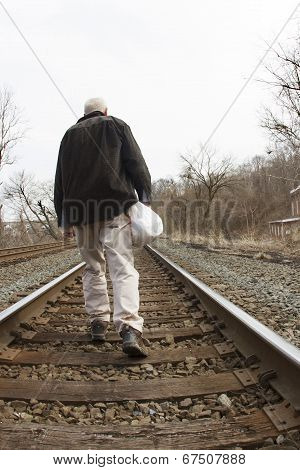 Homeless Man on Railroad Tracks