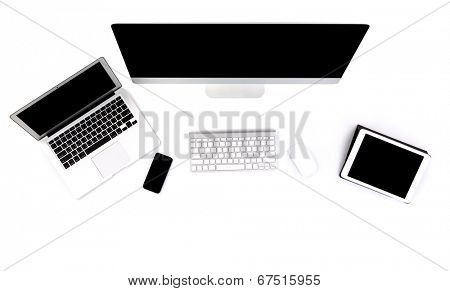 Computer ,laptop , tablet , smart phone on table