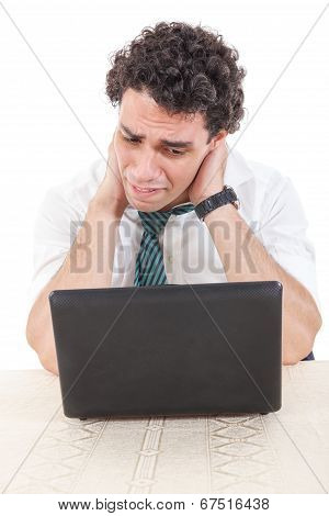 Caucasian Business Man Frustrated With Work Sitting In Front Of A Laptop With His Hands Around The N