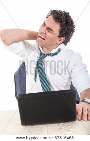 Desperate Caucasian Business Man Frustrated With Work Sitting In Front Of A Laptop With His Hand On