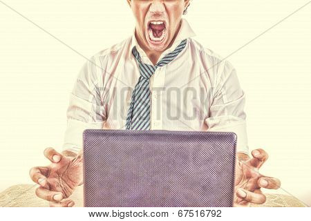 Half Face Business Man  With Laptop In Front Him On Office Desk At His Work