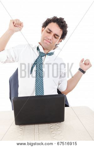 Man Frustrated With Work Sitting In Front Of A Laptop With His Hands Up, Stretch Up