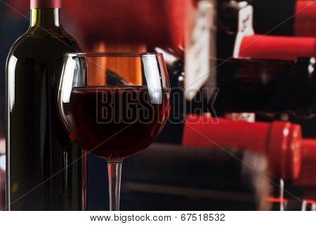 Wine Glass Near Bottle In Wine Cellar With Space For Text