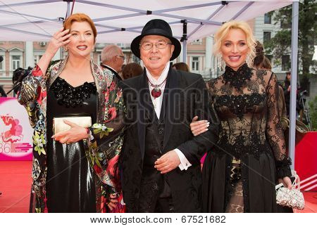 MOSCOW - JUNE, 28: Russian Actress V. Sotnikova, designer V. Zaitsev and model. 36st Moscow International Film Festival. Closing Ceremony at Rossiya Cinema . June 28, 2014 in Moscow, Russia