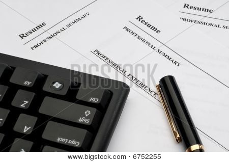 Computer Keyboard And Pen On Resumes