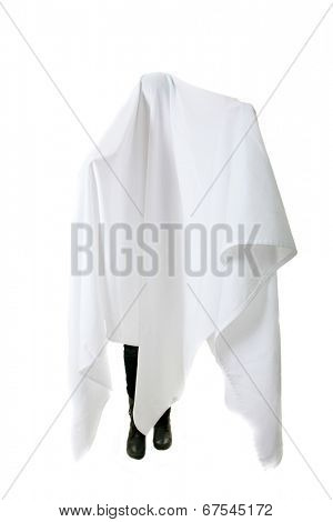A genuine Human wears a White Sheet over their head and body to pretend to be a Ghost so they can scare people. Isolated on white with room for your text. Ghost are very scary and go Boo a lot.