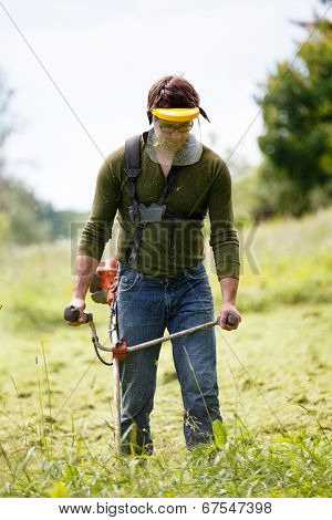 Man Working With Grass Trimmer
