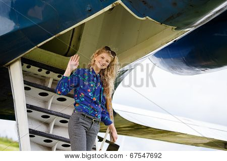 Woman Coming From Airplane