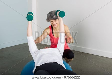 Smiling Middle Aged Sports Trainer With Athlete