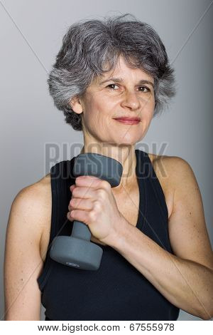 Middle Aged Female Sports Trainer With Dumbbell