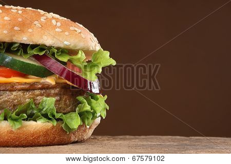 Tasty hamburger on wood background