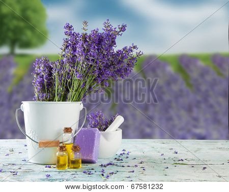 Harvested lavender flowers on wooden planks, blur field on background poster