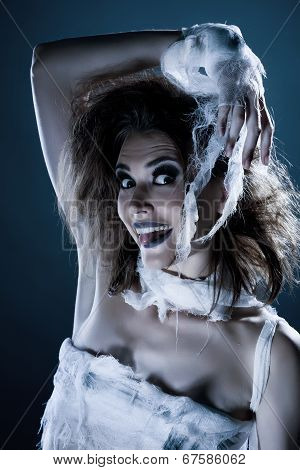 Portrait of cheerful girl-zombie posing at camera, close-up poster