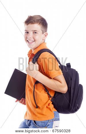 Portrait of a school boy with backpack holding a notebook, isolated on white background