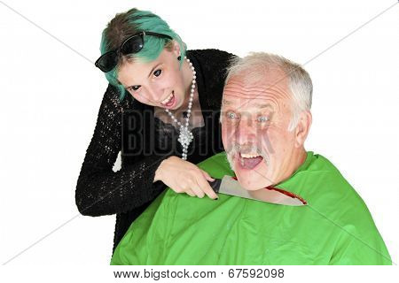 A vampire girl with black eyes and blue hair cuts the throat of her latest victim with a kitchen butcher knife. Isolated on white with room for your text.