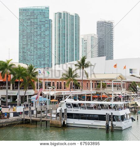 MIAMI,USA - MAY 27,2014 : The Bayside Marketplace in downtown Miami with a view of the yachts docked at the site and the skyscrapers surrounding the area