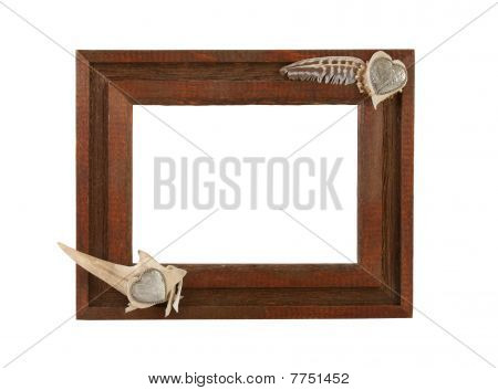 Rough wooden frame with antler and silver concho hearts poster