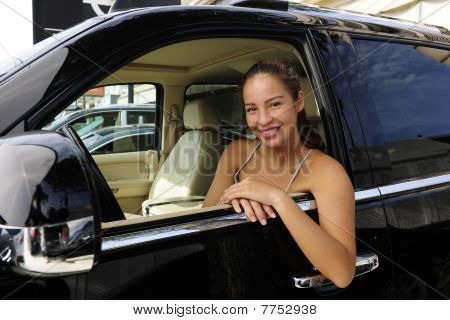 Woman Sitting Inside Of Her New 4X4 Off-road Vehicle