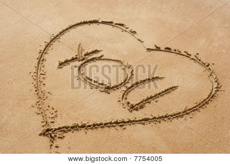 Heart Shape Symbol With The Word You On Sandy Beach