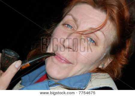 Portrait Of Middle-aged Woman Holding Pipe.