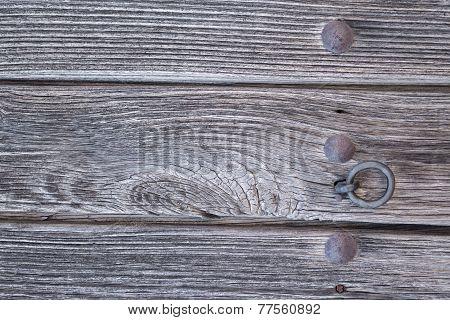 Old run-down wooden door and doorknocker