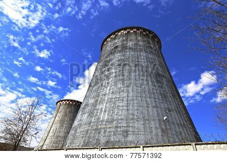 Large factory chimneys on blue sky background poster