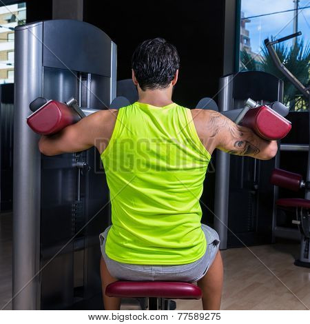 Deltoids fly machine man for shoulders workout at gym